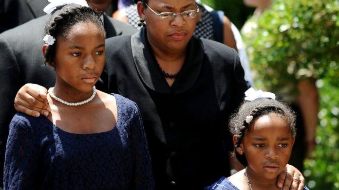 Eliana Pinckney (left) and Malana Pickney (right) with mother, Jennifer (center) walking to the South Carolina statehouse